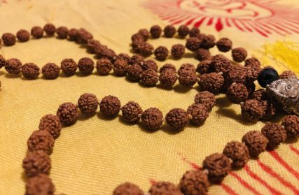 Traditional Mala placed on Indian scarf